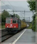 re-420-re-4-4-ii-/88666/re-420-310-5-mit-einem-postzug Re 420 310-5 mit einem Postzug in La Tour de Peilz. 5. August 2010