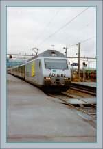 re-460-re-4-4-vi/148559/die-sbb-re-460-016-9-adtranz Die SBB Re 460 016-9 'ADtranz' erreicht im Sommer 1997 Delémont.  (Gescanntes Negativ)