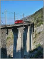 re-460-re-4-4-vi/81150/re-460-schiebt-am-21-april Re 460 schiebt am 21. April 2007 einen IC über das 116 Meter lange Luegelkinn Viadukt bei Hohtenn (BLS Südrampe).