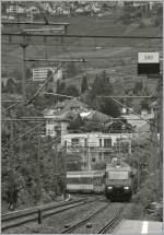 re-460-re-4-4-vi/88668/460-005-3-erreicht-mit-ihrem-ir 460 005-3 erreicht mit ihrem IR nach Birg die Haltestelle La Tour de Peilz, wo jedoch der Zug ohne Halt durchfahren wird. 5. August 2010