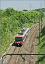 bem-550/92932/bem-550-001-zwischen-russin-und Bem 550 001 zwischen Russin und Satigny auf der Fahrt Richtnung Genève. Gut ist die schwere SNCF Gleichstrom Fahrleitung zu erkennen. 29. Mai 2009