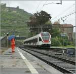 flirt-alle-br/89431/regen-pfuetzen-und-schirm-zeigen-es Regen: Pfützen und Schirm zeigen: es regnet, als der Flirt am 16. August 2010 Rivaz erreicht.