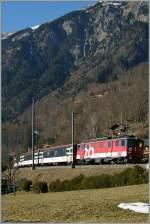 zb-zentralbahn/180610/der-zb-de-44-110-022-1 Der 'zB' De 4/4 110 022-1 mit eine IR Interlaken Ost - Luzern bei der Haltestelle Brienz West.  2. Feb. 2011