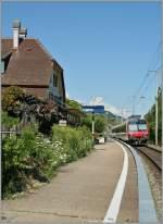Steuerwagen/283647/der-regionalzug-5153-verlaesst-von-neuchtel Der Regionalzug 5153 verlässt von Neuchâtel nach Biel/Bienne verlässt den Haltepunt Ligerz.  31. Juli 2013